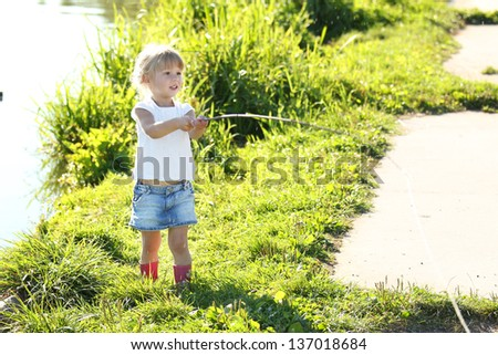 beautiful little girl on nature near lake