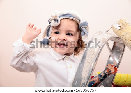 beautiful little girl painting and smiling