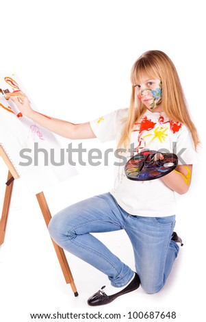 Beautiful little girl painting over white background - stock photo