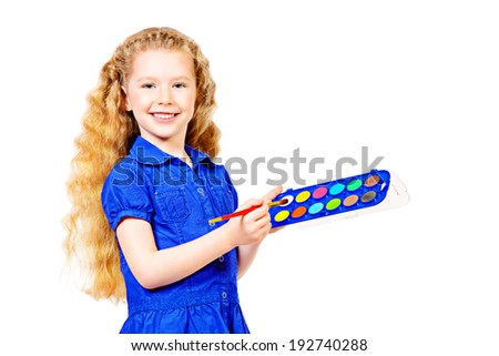 Beautiful little girl painting with a brush and watercolor. Isolated over white. - stock photo