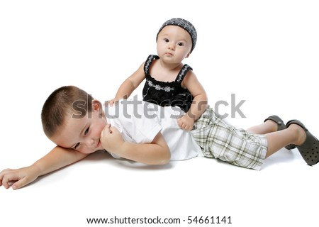Beautiful little girl playing with her big brother - stock photo