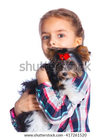 Beautiful little girl playing with her yorkshire terrier. Isolated on the white background - stock photo