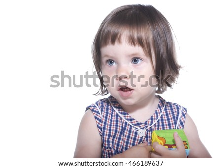 beautiful little girl plays with cubes. isolated on white background