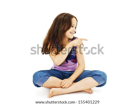 Beautiful little girl pointing with finger. Isolated on white background
