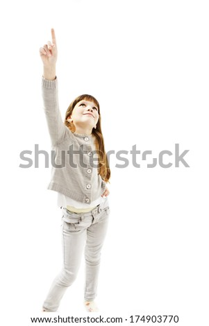 Beautiful little girl pointing with finger. Isolated on white background  - stock photo