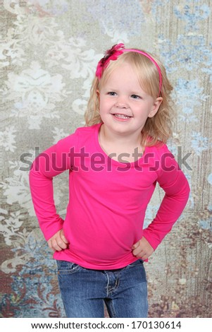 Beautiful Little Girl Posing for Camera in Studio