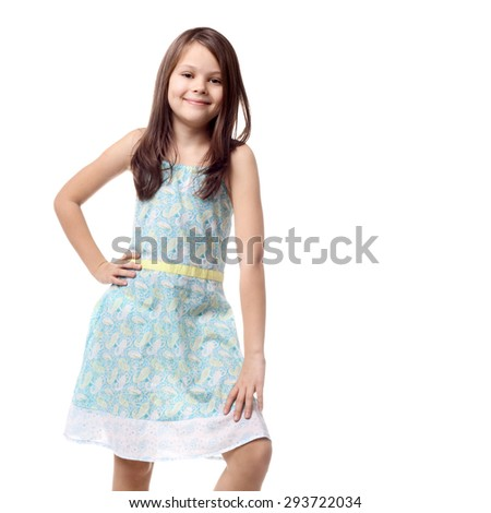 beautiful little girl posing in the summer dress