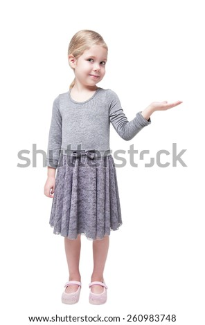Beautiful little girl presenting something on her hand isolated over white background - stock photo