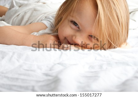 Beautiful little girl smiling after waking up