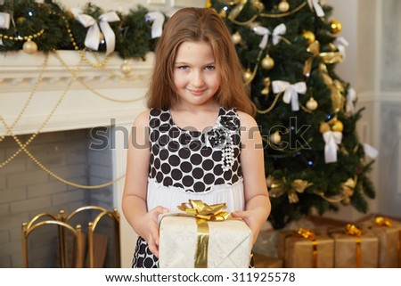 beautiful little girl surprised Christmas gifts