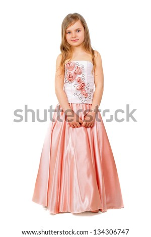 Beautiful little girl wearing nice peach dress. Isolated on white