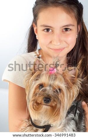 beautiful little girl with a dog