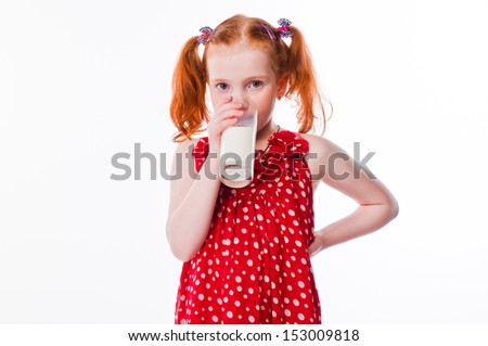 beautiful little girl with a glass of milk