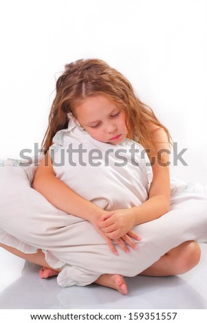 Beautiful little girl with a pillow