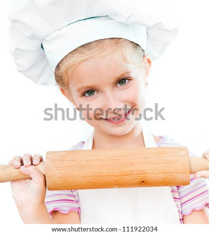 beautiful little girl with a rolling pin on a white background - stock photo