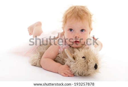 Beautiful little girl with a toy dog