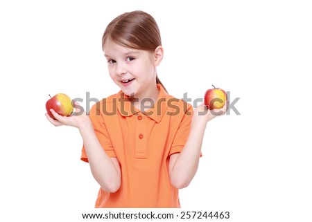 beautiful little girl with apples over white isolated white background