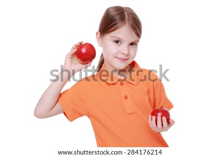 beautiful little girl with apples over white isolated white background - stock photo
