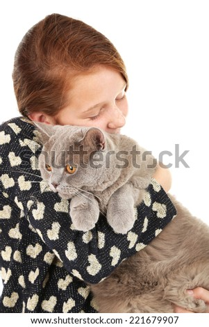 Beautiful little girl with cat isolated on white
