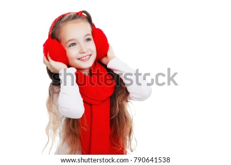 Beautiful little girl with earphones in red on a white background, isolated