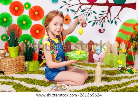 beautiful little girl with easter eggs - stock photo