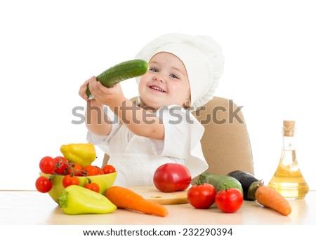 beautiful little girl with food vegetables over white