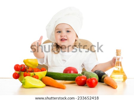 beautiful little girl with food vegetables over white - stock photo