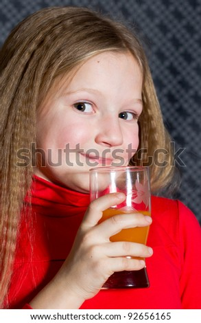 Beautiful little girl with glass in hands
