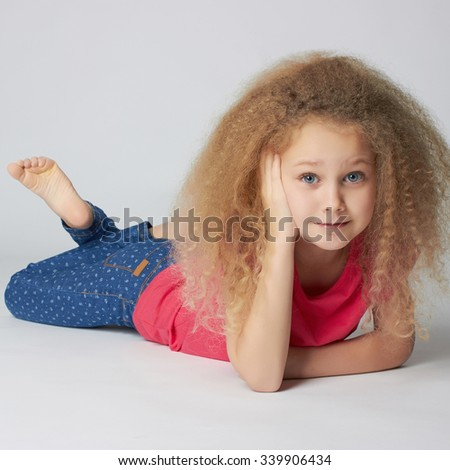 beautiful little girl with healthy curly hair.funny child - stock photo