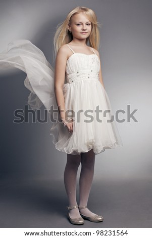 beautiful little girl with long hair blonde on a white background - stock photo