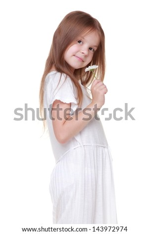 Beautiful little girl with long hair holding a white daisy on Beauty and Fashion
