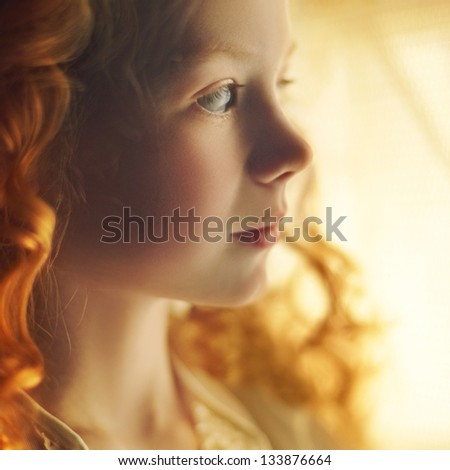 Beautiful little girl with long red curls hair - stock photo