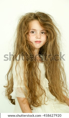 beautiful little girl with messy hair
