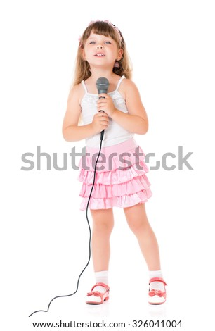 Beautiful little girl with microphone isolated on white background - stock photo