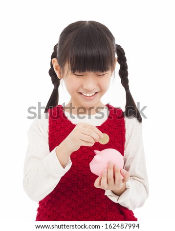 beautiful little girl with piggy bank - stock photo