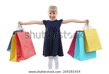 Beautiful little girl with shopping bags isolated on white - stock photo