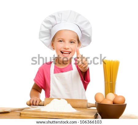 beautiful little girl with spaghetti, flour and eggs on a white background