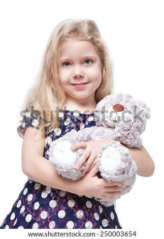 Beautiful little girl with teddy bear isolated over white background - stock photo