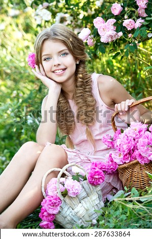 Beautiful little girl with wreath of roses on nature - stock photo
