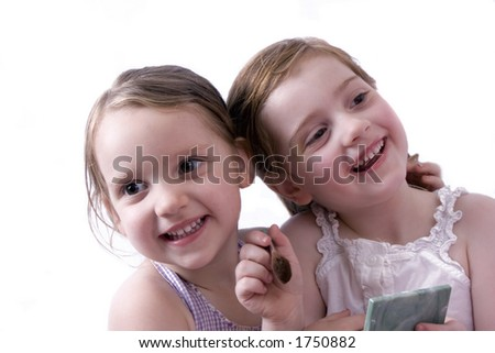 Beautiful little girls playing and laughing.