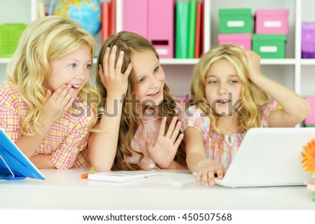 beautiful little girls with laptop