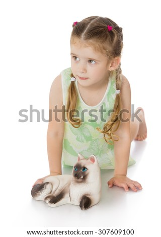 Beautiful little green-eyed girl with blond hair braided in tiny braids plays on the floor with the cat-Isolated on white background