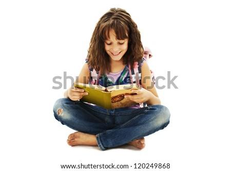 Beautiful little schoolgirl sitting on floor studying. Isolated on white background - stock photo