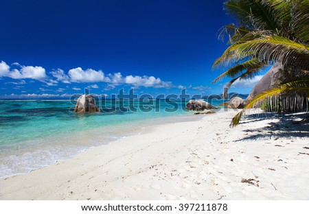 Beautiful little secluded beach at tropical La Digue island on Seychelles - stock photo