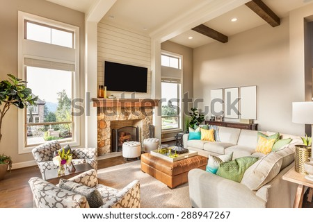 Beautiful living room in brand new luxury home with hardwood floors and amazing view