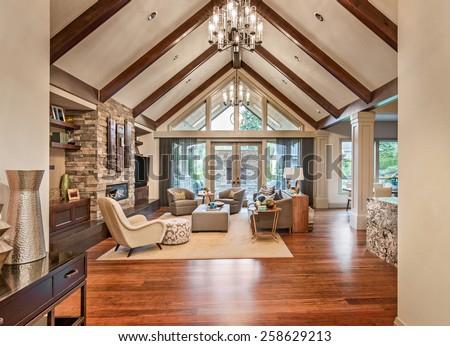 hardwood living room. Beautiful living room in luxury home with hardwood floors  tv fireplace and vaulted Living Room Luxury Home Hardwood Stock Photo 258629213
