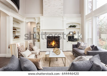 Beautiful Living Room Interior With Hardwood Floors And Fireplace In New  Luxury Home. Large Bank