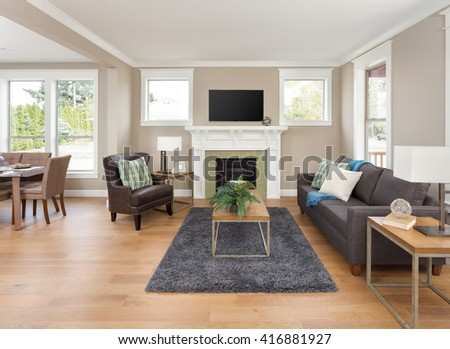 Beautiful Living Room Interior With Open Floor Plan Shows Hardwood Floors And Fireplace In New