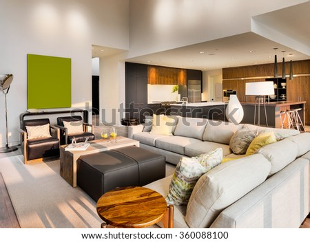 Beautiful living room with hardwood floors and couch in new luxury home - stock photo