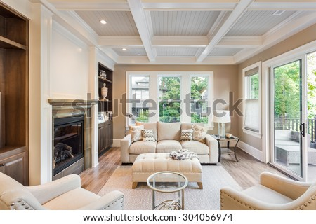 Beautiful living room with hardwood floors and  in new luxury home - stock photo